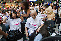 Patients of Cancer try on their new wigs, as a commitment to actively fight against cancer in Medellin, Colombia, May 25, 2012.  Colombia celebrated on 31 January, 7, 14 and 21 February some days of donating hair in Beauty Centres Fundayama ALQVIMIA and foundation (Foundation for support and support people with breast cancer), it received 300 donations of hair with which they made 200 wigs  Photo by Fredy Amariles/View