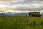 Idaho, Eastern, Driggs, A barn beneath the Teton Mountains in the Teton Valley in summer.