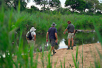 KLASERIE PRIVATE GAME RESERVE, SOUTH AFRICA, DECEMBER 2004. Gary points out crocodil tracks. Wildlife guide Gary Freeman takes people on walking safaris in the bush. Photo by Frits Meyst/Adventure4ever.com