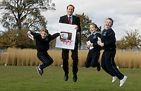 ***NO FEE PIC***.15/11/2010.Minister for Children Barry Andrews TD .with (L to R).Lorraine Dunster (9) from Sallynoggin.Shannon O' Malley from (9) from Sallynoggin.Roisin Kearns-Owens (8) from Sallynogin.at the launch of Children's Hope.TV at The Media Cube, IADT,Dun Laoghaire, Co. Dublin..The Irish children's Charity Children's Hope has developed an online educational resource for young people & youth workers, a website caleed www.childrens-hope.tv..The websitte features short curriculm-adhering educational programmes available to be played by young people in after-school projects geared to Youth & Comunity Leaders..Photo: Gareth Chaney Collins