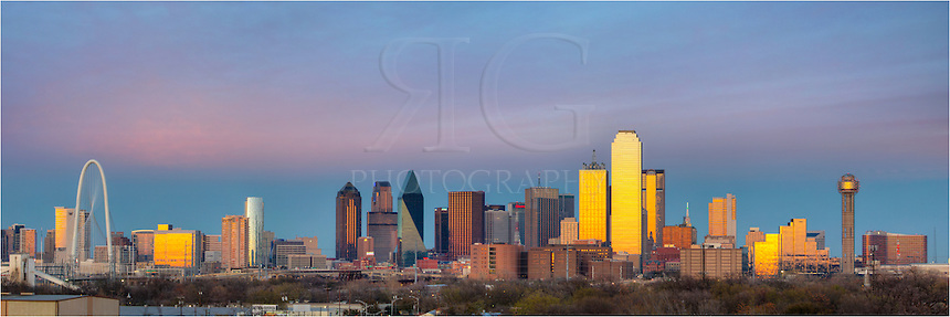 From the east side of Dallas, this Dallas skyline panorama is a stitch of several images taken about just after sunset when the sky still showed some faint color. The sun was setting behind me so the clouds were not as spectacular as they would be had you been facing west. ..On the far left, you can see the new Margaret Hunt Hill Bridge and on the far right stands the iconic Reunion Tower. Reunion Tower is the 5th tallest observatory in the United States...In the middle of the image, outlined is green, is the tallest building in Dallas, the 72-story Bank of America Plaza. The Bank of America Plaza is, at the time of this posting, the 22nd tallest building in the United States and 3rd tallest in Texas. To the left of the America Plaza is the Renaissance Tower, a 56-story building finished in 1987. Further to the left of the Renaissance Tower and the Bank of America Plaza stands the triangular, 62-floor Fountain Place...These buildings, along with many others, give the Dallas skyline a classic feel and a sight worthy of viewing.
