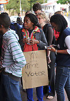 Excited first time voter Nkateko Mnisi (19, a medical student) queues for a free cuppa after casting her ballot at a polling station in Rondebosch on the morning of the 2009 general election. Anyone who had voted was offered a free coffee by a local fast food outlet.