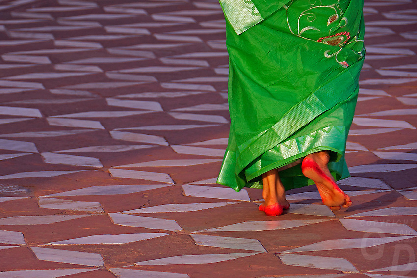 Alta a red color dye and an Indian tradition of decorating feet. An Indian Women paint their feet in deep red, specially during marriages, festivals or during visits of important religious monuments and shrines.The Taj Mahal, Agra India