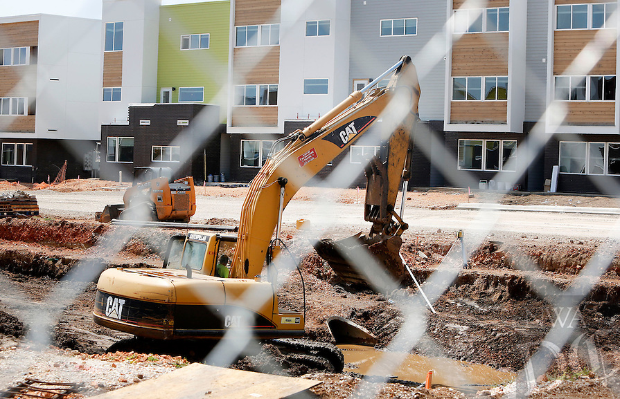 NWA Democrat-Gazette/DAVID GOTTSCHALK  Work continues at Beechwood Village Wednesday, August 26, 2015 in Fayetteville. The new apartment complex is aimed at University of Arkansas students and opened Saturday offering 12 different floor plans.
