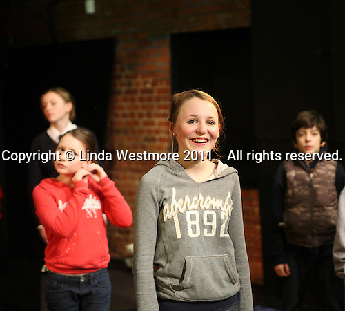 "Drama group for 8-13s rehearsing a production of ""Alice"" in the Mill Studio at the Yvonne Arnaud Theatre, Guildford, Surrey."
