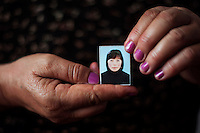 Dinarkul holds a photograph of her 19 year old daughter, Urus Kasymbay, who commited sucide after she was kidnapped and forced into marriage. Urus was a student studying journalism and had a boyfriend whom she wanted to marry. She was kidnapped by a 34 year old  stranger but two days later her family freed her. However, the day after her return she hanged herself in the backyard of her home. Her mother says: 'My daughter was very cheerful and smart. I am against bride-kidnapping in Kyrgyzstan'. Although illegal, bride kidnapping is common in rural parts of Kyrgyzstan. Each year around 16, 000 women become married after being kidnapped. They are known as 'Ala Kachuu' that translates as 'to grab and run away'. Defenders of the continuation of the practice sight tradition. However, during Soviet Times it was rare, and parents generally arranged marriages..