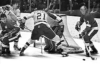 California Golden Seals , Ron Stackhouse and goalie Gary Smithdefend against  Redwing #7 Gary Unger...(1970 photo/Ron Riesterer)