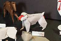 New York, NY, USA - June 22, 2012: A display at the OrigamiUSA 2012 convention exhibition held at Fashion Institute of Technology in New York City. This complex model, folded from one square of paper, of a Japanese macaque monkey was designed and created by Japanese artist Hideo Komatsu.