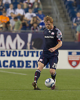 New England Revolution defender Pat Phelan (28) passes the ball. The Chicago Fire defeated the New England Revolution, 1-0, at Gillette Stadium on June 27, 2010.