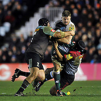 Ed Slater of Leicester Tigers is double-tackled by Mark Lambert and Winston Stanley of Harlequins. Aviva Premiership match, between Harlequins and Leicester Tigers on February 19, 2016 at the Twickenham Stoop in London, England. Photo by: Patrick Khachfe / JMP