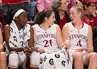STANFORD, CA - January 3, 2014: Stanford Cardinal's Chiney Ogwumike, Sara James, and Taylor Greenfield during the Pac-12 Opener versus the Oregon Ducks at Maples Pavilion.  Stanford defeated the Ducks 96-66.