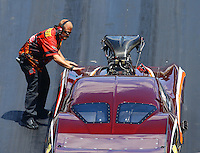 Jun 18, 2016; Bristol, TN, USA; Crew member with NHRA pro mod driver Chuck Little during qualifying for the Thunder Valley Nationals at Bristol Dragway. Mandatory Credit: Mark J. Rebilas-USA TODAY Sports