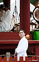 April 11, 2011, Kamakura, Japan - A shinto member belonging to the shrine looks off in the distance during a special commemorative event at Hachimangu Shrine to offer prayers for the relief of the March 11 earthquake and tsunami victims. Today is exactly one month since the devastating disaster that left Tohoku with almost nothing to spare. (Photo by Christopher Jue/AFLO) [2331].