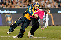 Melbourne, 24 July 2015 - A pitch invader is tackled by security in game three of the International Champions Cup match between Manchester City and Real Madrid at the Melbourne Cricket Ground, Australia. Real Madrid def City 4-1. (Photo Sydney Low / AsteriskImages.com)