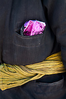 Detail of the coat of a Kyrgyz man preparing the yak caravan. In and around the camp of Ak Chyktash..Trekking with yak caravan through the Little Pamir where the Afghan Kyrgyz community live all year, on the borders of China, Tajikistan and Pakistan.