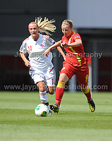 Hannah Keryakoplis of Wales battles with Julie Trustrup of Denmark during the UEFA Womens U19 Championships at Parc y Scarlets, Monday 19th August 2013. All images are the copyright of Jeff Thomas Photography-www.jaypics.photoshelter.com-07837 386244-Any use of images must be authorised by the copyright owner.