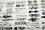Waterbury, CT- 17 April 2017-041717CM03-  Symbols made via print stamping are shown during an International Arts Festival at the Leever Auditorium at the Naugatuck Valley Community College on Monday.  The symbols which are native to Ghana, were part of an event  that featured various ethnic musical performances, interactive origami and Adinkra printing, exhibitions and a variety of international foods.    Christopher Massa Republican-American