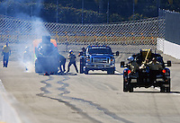 Feb. 27, 2011; Pomona, CA, USA; NHRA safety safari crews extinguish fire from the car of funny car driver Bob Bode after having an engine fire during the Winternationals at Auto Club Raceway at Pomona. Mandatory Credit: Mark J. Rebilas-