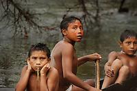 Viriunaveteri, Venezuela. Yanomami indians on the casiciare river ..The village of Viriunaveteri consists of 15 huts around a muddy square. It's situated in the Venezuelan Amazone several days by boat from the nearest town. This community on the banks of the Casiquiare is one of the few Yanomami villages that actually has some contact with the outside world. Most other tribes live deeper in the jungle.