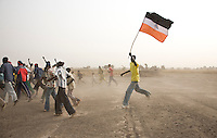 Teams parade as part of the opening cermony of the Twic Olympics in Wunrok, Southern Sudan.