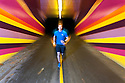 PE00284-00...WASHINGTON - Piierce Prohovost jogging in a pedestrian tunnel on the Burk Gilman Trail in Kenmore. (MR# P9)