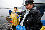Crab Fisherman Gary Le Marchant holds a Dungeness crab out to Kay Mills-Ginsborg. Le Marchant took a small group of people out on the water to learn the sport of crabbing during the &quot;Crab Catch Package&quot; workshop on his boat in the waters near Salt Spring Island, British Columbia. Photo assignment for the Globe and Mail national newspaper in Canada.
