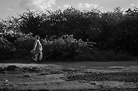 Kakuma, Kenya: A woman walks along the road leading into Kakuma refugee camp.