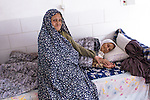 Muslim woman in her home, taking care of her mother, who suffers from Alzheimer's disease (Yazd, Iran, 2012).