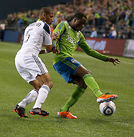 Seattle Sounders FC forward Steve Zakuani tries to keep the ball away from L.A. Galaxy defender Tyson Wahl Defender during play between the Seattle Sounders FC and the L.A. Galaxy at Qwest Field in Seattle Tuesday March 15, 2011. The Galaxy won the game 1-0.