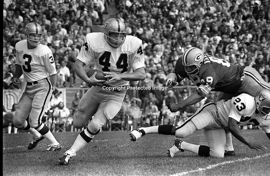 Oakland Raiders fullback Marv Hubbard gets a block from Charlie Smith, #3 Daryle Lamonica hands off, <br />