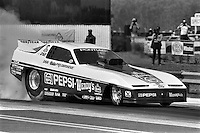"""GAINESVILLE, FL - MARCH 13: Don """"The Snake"""" Prudhomme drives his Pontiac Firebird Funny Car during the NHRA drag race at Gainesville Raceway near Gainesville, Florida, on March 13, 1983."""