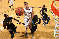 Dec. 17, 2010; Charlottesville, VA, USA;  Virginia Cavaliers guard Mustapha Farrakhan (2) shoots a basket over Oregon Ducks forward Jeremy Jacob (23), Oregon Ducks guard Teondre Williams (22) and Oregon Ducks guard Jay-R Strowbridge (55) during the game at the John Paul Jones Arena. Virginia won 63-48. Mandatory Credit: Andrew Shurtleff