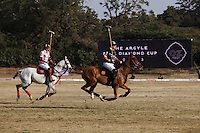Greg Johnson (right), captain of the Australian team and Maharaj Narendra Singh (left) captain of the Jaipur team chase the ball during a game between the Royal Jaipur Polo Team (in pink) and the Western Australia Polo Team (in black) for the Argyle Pink Diamond Cup, organised as part of the 2013 Oz Fest in the Rajasthan Polo Club grounds in Jaipur, Rajasthan, India on 10th January 2013. Photo by Suzanne Lee