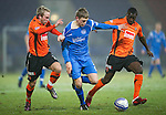 St Johnstone v Dundee United....22.02.11 .Murray Davidson is closed down by Johnny Russell and Prince Buaben.Picture by Graeme Hart..Copyright Perthshire Picture Agency.Tel: 01738 623350  Mobile: 07990 594431