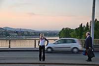 Central Europe, Hungary, Budapest 2007/04.Waiting the tram at dusk on Margaret bridge. Margaret bridge (Margit Hid) connect Buda and Pest across the Danube.