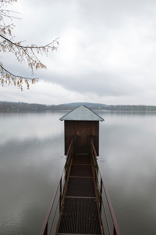 Fisherman's shed on a calm lake in early Spring, Southern Bohemia, Czech Republic, Europe