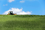 Watertown, CT- 18 May 2017-051817CM01-  A tractor makes it's way through a field on a farm off Aunt Olive Road in Watertown on Thursday. According to the National Weather Service, Friday is expected to be mostly sunny, with a high near 84.     Christopher Massa Republican-American