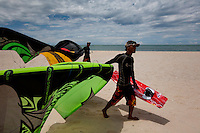Brothers, Hung, 24, right, and Doi, 20, learned English and became kite surfing instructors at STORM Kiteboarding five years ago.  They can make a year's wage Vietnamese standards in one good month teaching kite surfing.