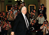 Chief United States House Manager Representative Henry Hyde (Republican of Illinois) leaves the U.S. Senate Chamber in the U.S. Capitol in Washington, D.C. past phalanx of photographers after the Senate vote acquitting President Clinton on February 12, 1999..Credit: Ron Sachs / CNP