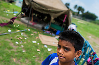 A Salvadorean boy stands in front of a living tent at the Circo Brasilia, a family run circus travelling in Central America, 10 May 2011. The Circo Brasilia circus belongs to the old-fashioned traveling circuses with a usual mixture of acrobat, clown and comic acts. Due to the general loss of popularity caused by modern forms of entertainment such as movies, TV shows or internet, these small family enterprises balance on the edge of survival. Circuses were pushed away and now they have to set up their shows in more remote villages. The circus art and culture is slowly dying in Latin America.