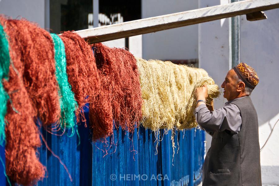 Uzbekistan, Samarqand.<br /> Silk carpet manufacture.<br /> Freshly dyed silk.