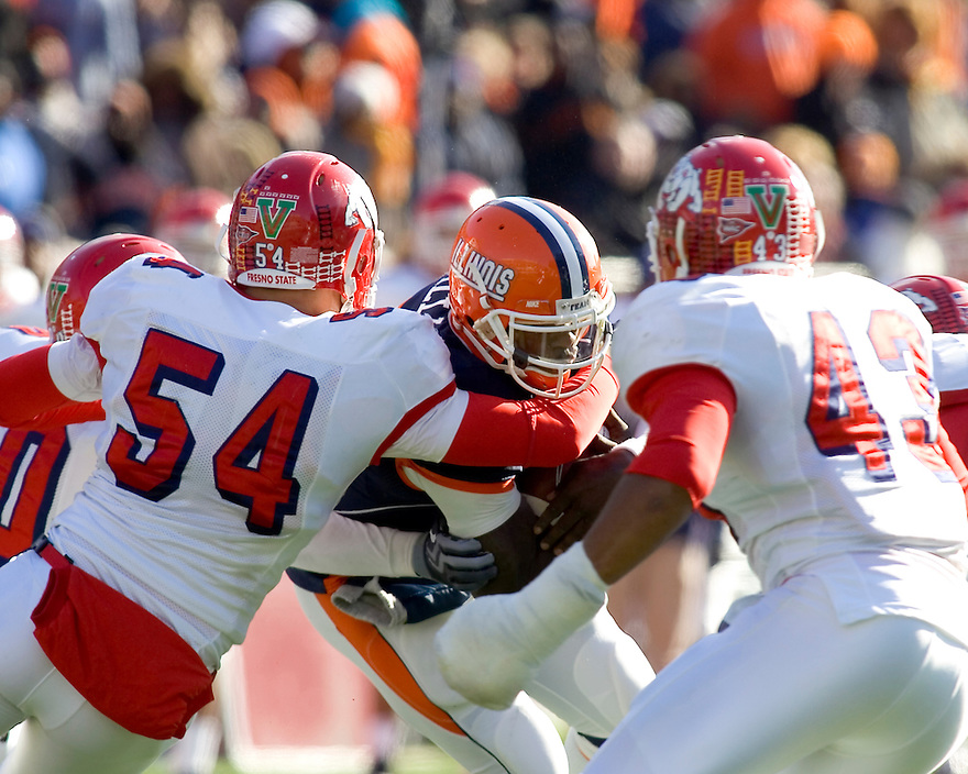 December 5, 2009 - Champaign, Illinois, USA -   Fresno State linebacker Ben Jacobs sacks Illinois quarterback Juice Williams in the game between the University of Illinois and Fresno State at Memorial Stadium in Champaign, Illinois.  Fresno State defeated Illinois 53 to 52..