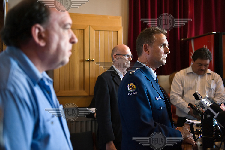 Police Superintendent Gary Knowles (centre right) and Peter Whittal, CEO of Pike River Coal (left), speak at a press conference. 29 miners were missing following an explosion at Pike River coal mine on 19/11/2010.