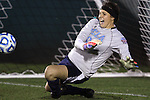 06 December 2013: UCLA goalkeeper Katelyn Rowland makes a save during the penalty kick shootout. The University of California Los Angeles Bruins advanced over the University of Virginia Cavaliers in penalty kicks following a 1-1 tie at WakeMed Stadium in Cary, North Carolina in a 2013 NCAA Division I Women's College Cup semifinal match.