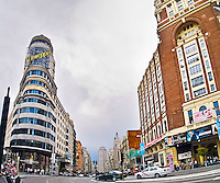 MADRID, SPAIN - MAY 20: Main commercial street in Madrid, Gran Via on 20, 2011 in Madrid, Spain. The middle point of the street with commerces and traffic