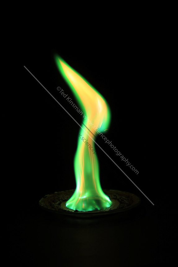 Copper(II) chloride (CuCl2) emits a green-blue glow in a flame test.  In this experiment the copper chloride is placed in a watch glass and saturated with ethanol.  The burning ethanol heats the copper to show the characteristic green flame.