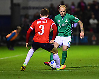 Lincoln City's Bradley Wood plays the ball forward under pressure from York City's Alex Whittle<br /> <br /> Photographer Andrew Vaughan/CameraSport<br /> <br /> The Buildbase FA Trophy Semi-Final First Leg - York City v Lincoln City - Tuesday 14th March 2017 - Bootham Crescent - York<br />  <br /> World Copyright &copy; 2017 CameraSport. All rights reserved. 43 Linden Ave. Countesthorpe. Leicester. England. LE8 5PG - Tel: +44 (0) 116 277 4147 - admin@camerasport.com - www.camerasport.com