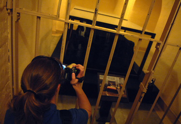 Kelly Corr, sister of Officer Joe Corr, New Hartford, N.Y. Police Department, who was killed in the line of duty 2/27/06, takes a picture of the Lincoln Catafault during a Capitol tour from Capitol Police Officer Kathleen McBride.