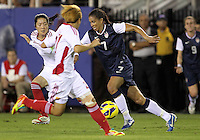 BOCA RATON, FL - DECEMBER 15, 2012: Shannon Boxx (7) of the USA WNT races past Pu Wei (11) of China WNT during an international friendly match at FAU Stadium, in Boca Raton, Florida, on Saturday, December 15, 2012. USA won 4-1.