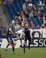 Chivas USA defender Dario Delgado (12) and New England Revolution forward Zack Schilawski (15) battle for head ball. Chivas USA defeated the New England Revolution, 4-0, at Gillette Stadium on May 5, 2010.